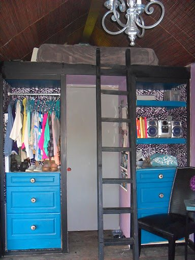 """On the left side is my 24"""" closet. The right side bank of drawers hides the 20 gal water heater. The sleeping loft is up top and the grey door leads to the bathroom."""